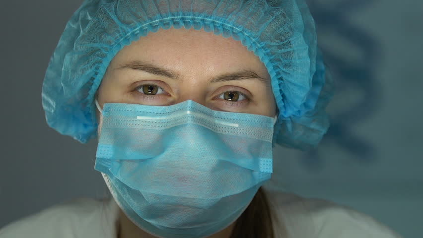Female lab assistant wearing safety glasses before chemical research, close-up | Shutterstock HD Video #1026309857