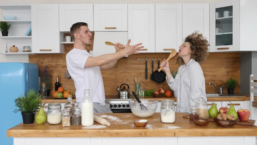 Young Family Couple Dancing And Singing In Kitchen At Home | Shutterstock HD Video #1026324338