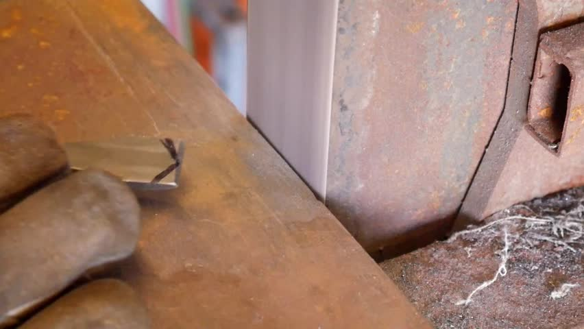 A Metalworker Grinding A Chisel to Shape with a Sander   Shutterstock HD Video #1026343418