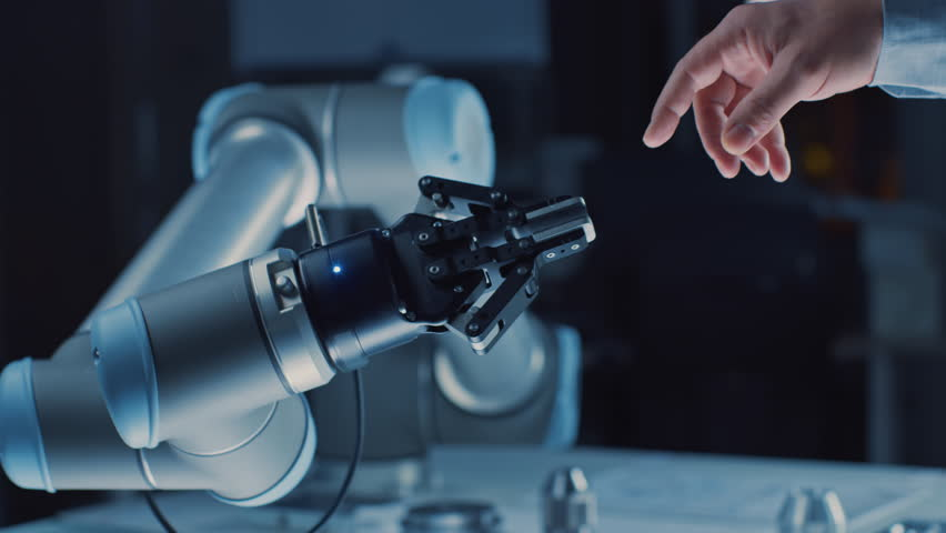 Futuristic Robot Arm Touches Human Hand in Humanity and Artificial Intelligence Unifying Gesture. Conscious Technology Meets Humanity. Concept Inspired by Michelangelo's Creation of Adam Royalty-Free Stock Footage #1026344120