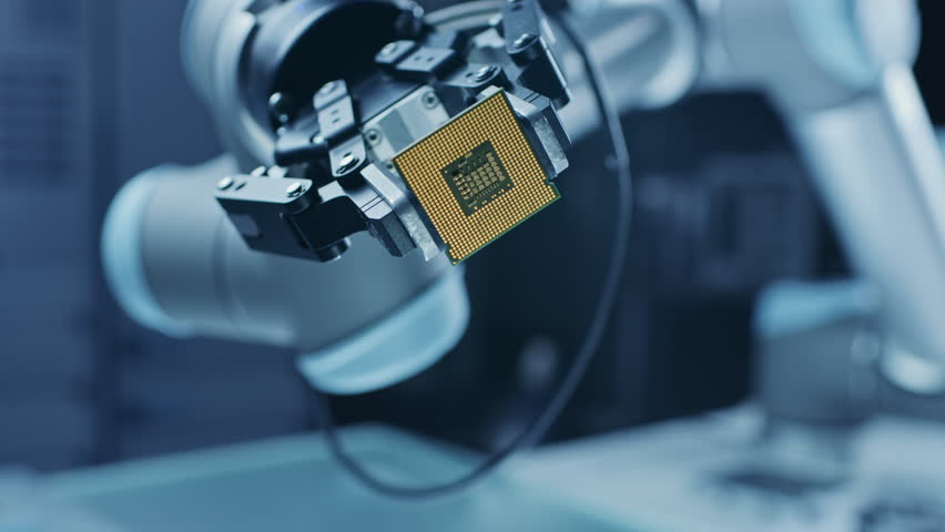 Modern High Tech Authentic Robot Arm Holding Contemporary Super Computer Processor Smoothly Moving into Focus. Industrial Robotic Manipulator End Effector Holding CPU Chip Moves Towards Camera Focus Royalty-Free Stock Footage #1026344636