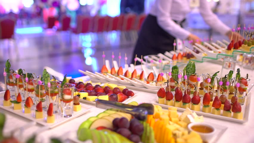 Beautifully decorated catering banquet table with snack canape in restaurant or hotel. catering service bisiness waiter buffet food set in event celebratoin corporate birthday kids party or wedding Royalty-Free Stock Footage #1026347945