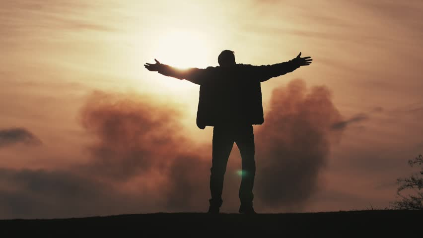 Cheerful view of inspired man in jacket and pants dancing, keeping hands aside and turning around at dark and cloudy sunset in slow motion  #1026350426