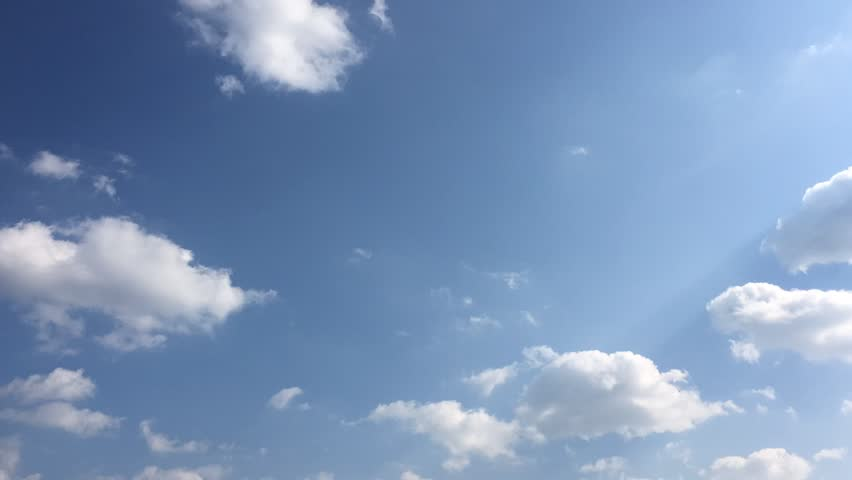 Beautiful blue sky with clouds background.Sky clouds.Sky with clouds weather nature cloud blue.Blue sky with clouds and sun. | Shutterstock HD Video #1026360101