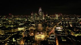 Aerial drone night video of iconic Saint Paul landmark Cathedral in the heart of City financial district of London, United Kingdom