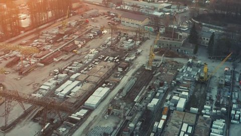 Aerial view of the concrete products factory (plant) in industrial area at sunset