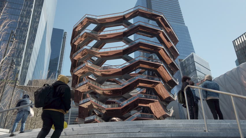 """New York, NY / USA - March 22, 2019: Vessel (""""Hudson Yards Staircase""""), a public landmark by the Hudson Yards near the Hudson River opened on March 15, 2019. Architect: Thomas Heatherwick."""