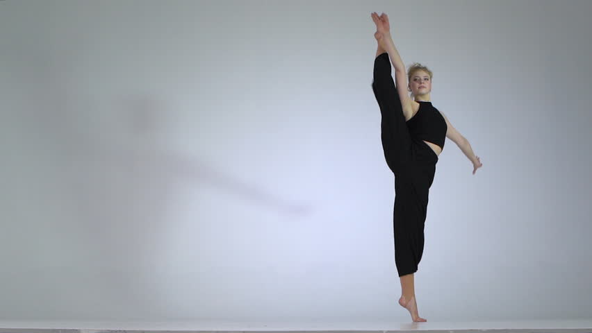 A girl does acrobatic elements in slow motion | Shutterstock HD Video #1026394319