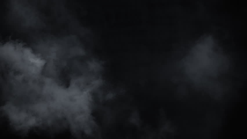 Atmospheric smoke VFX overlay element. Haze background. Smoke in slow motion on black background. White smoke slowly floating through space against black background. Mist effect. Fog effect.