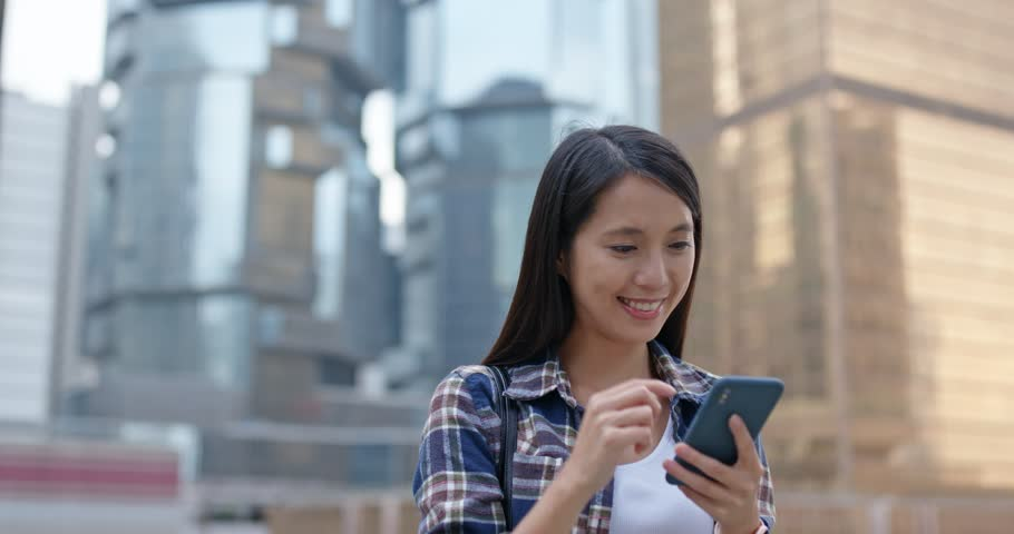 Young woman work on smart phone | Shutterstock HD Video #1026433532