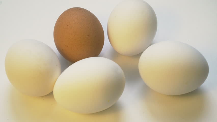 Hammer crash diffferent color egg, xenophobia, racism concept, crime | Shutterstock HD Video #1026470933