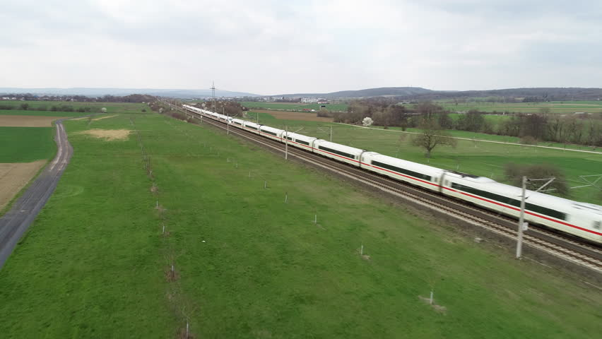 Wallau, Germany - March 27, 2019: A German ICE highspeed train passing by on the Frankfurt-Cologne line near Wallau, Germany. The maximum speed of these trains is around 320km/h