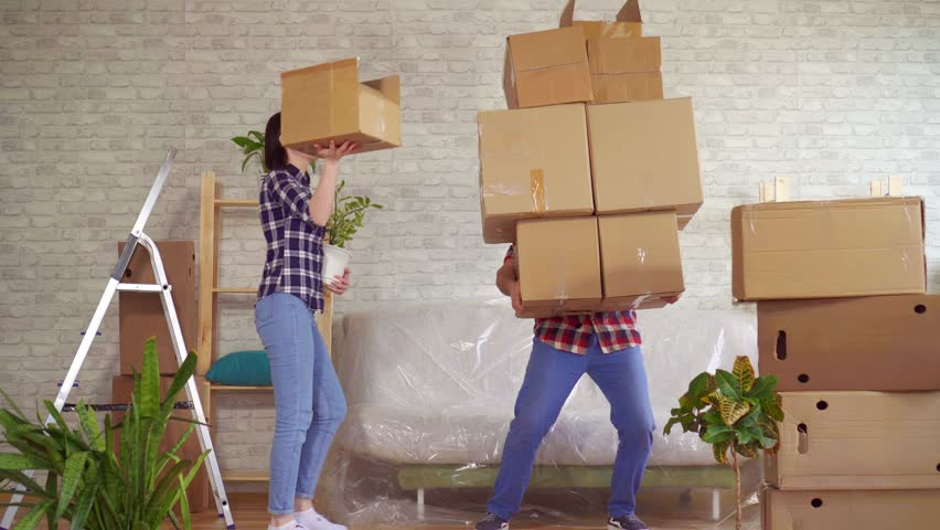 Fale man falls with boxes, problems when moving to a new apartment   Shutterstock HD Video #1026519848