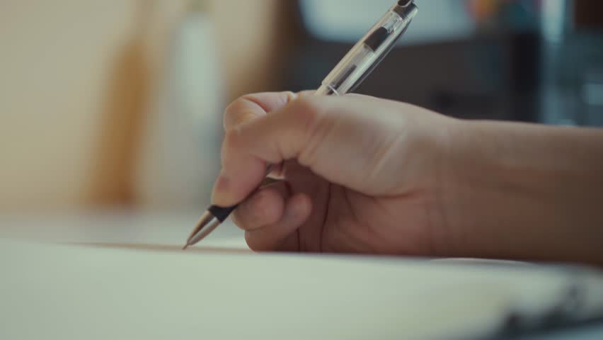 A male hands writing on a piece of paper. Writing essay or letters. Doing homework. | Shutterstock HD Video #1026523883