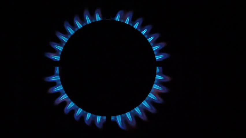 Kitchen burner flaming in the night, closeup. Top View | Shutterstock HD Video #1026528125