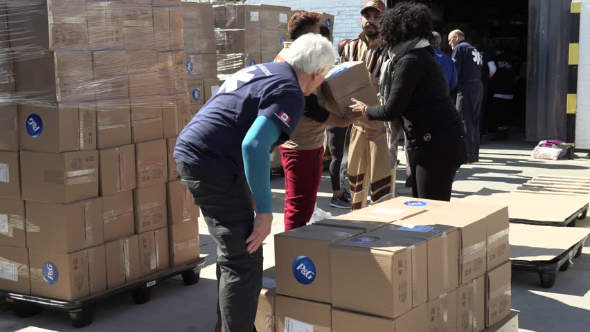 Toronto, Ontario, Canada March 2019 Global medic aid workers in Toronto package emergency help for Cyclone Idai victims in Mozambique