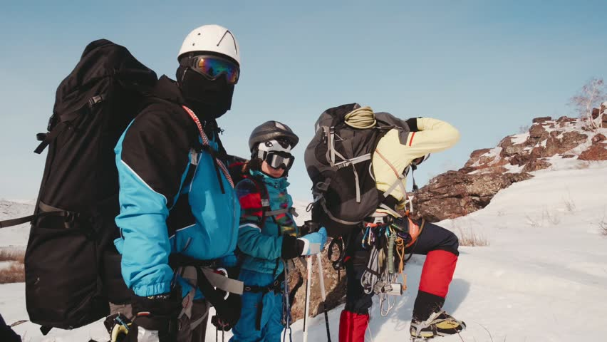 The group of travelers stopped at the side of a mountain, to test and to improve their professional equipment | Shutterstock HD Video #1026535196