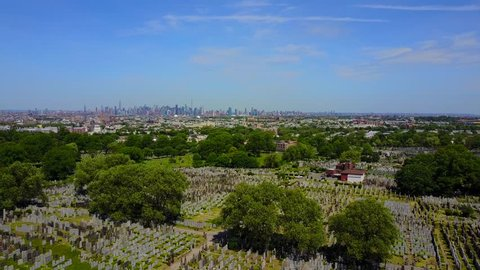 Queens, NY/USA - May 28, 2017: Flying through Cypress Hills Cemetery in Queens, NY.
