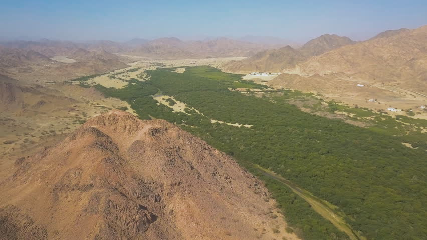 Al-Ula, Saudi Arabia. Overlooking the mountain valley landscale, and oasis area of the Alula town from the fort (aerial view)