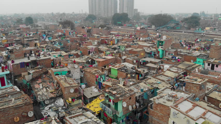 4k aerial view of Indian slum  in a situation of deteriorated, incomplete infrastructure, lacking in reliable sanitation services, supply of clean water, reliable electricity & other basic services.