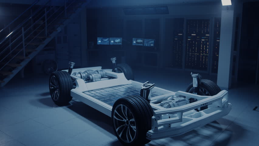 Concept of Authentic Electric Car Platform Chassis Prototype Standing in Industrial Machinery Design Laboratory. Hybrid Bridge Frame include Tires, Suspension, Engines, Brakes and Battery. | Shutterstock HD Video #1026560414