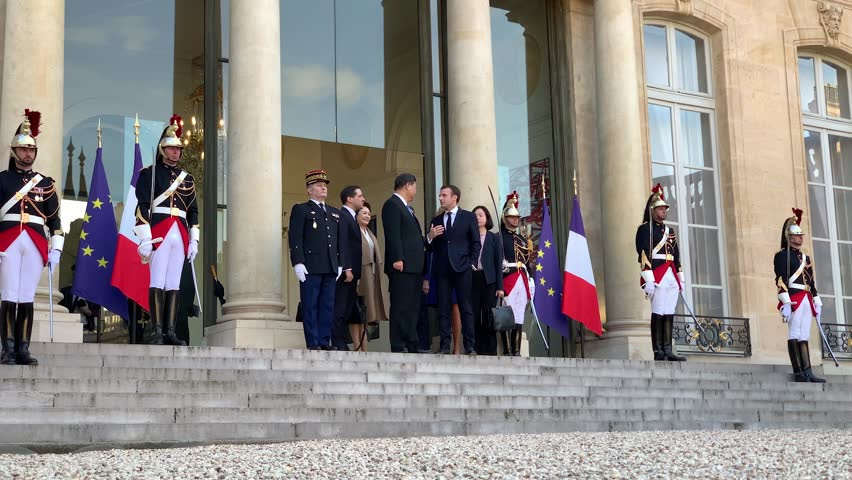 PARIS, FRANCE - MARCH 26, 2018 : Emmanuel Macron and his wife Brigitte Macron with the chinese President Xi Jinping and his wife Peng Liyuan for their state visit in France at the Elysee Palace. | Shutterstock HD Video #1026563645