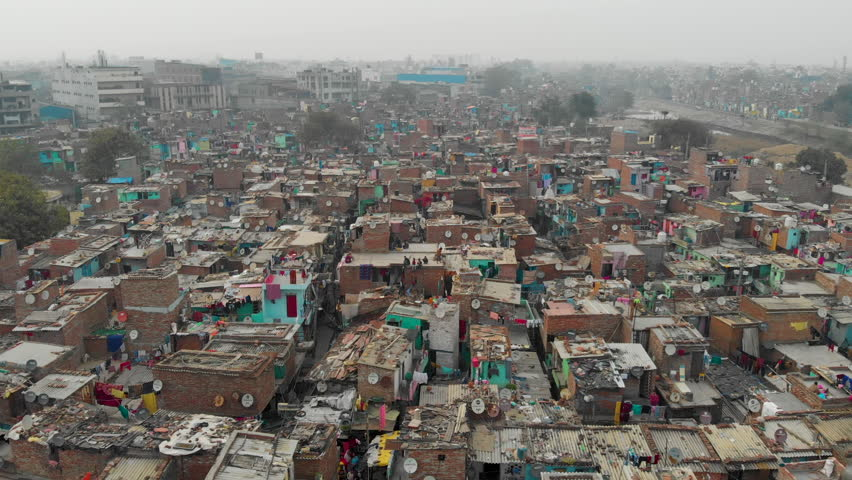 Slums, Delhi, India, February 19th 2019: 4k aerial view of Indian slum  in a situation of deteriorated, incomplete infrastructure, lacking in reliable sanitation services, supply of clean water...