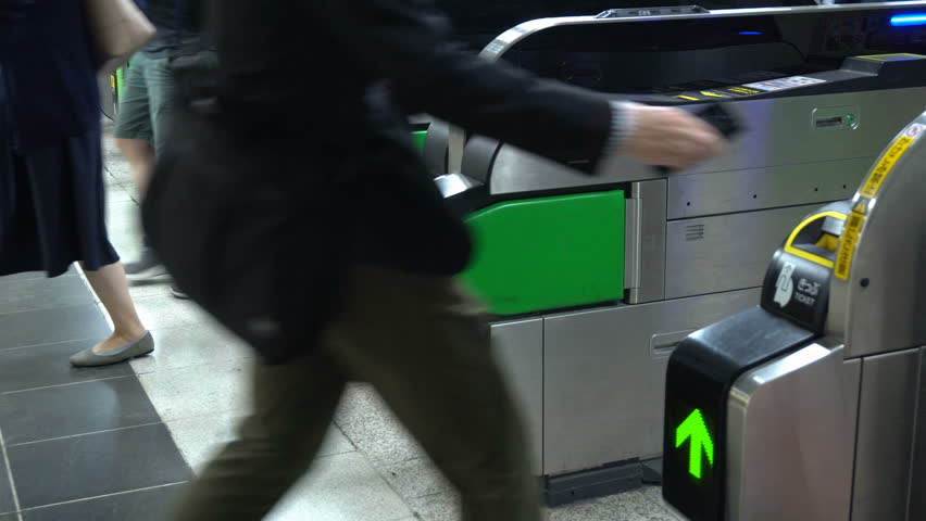 Anonymous Commuters Passing Through Ticket Gate At Subway Station | Shutterstock HD Video #1026596003