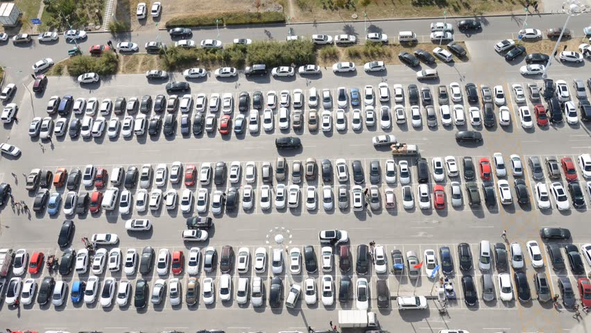 Aerial view of a parking lot in time-lapse format straight down | Shutterstock HD Video #1026606005