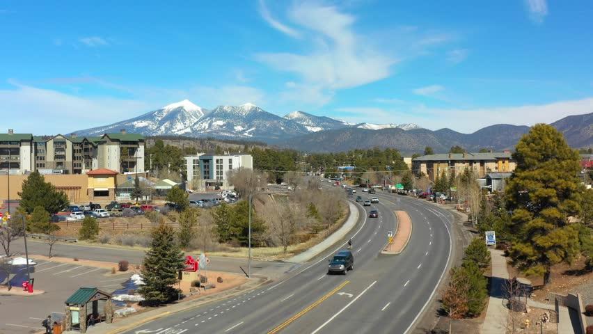 FLAGSTAFF, AZ, USA - MARCH 10, 2019: Aerial video Flagstaff Arizona view of Humphreys Peak