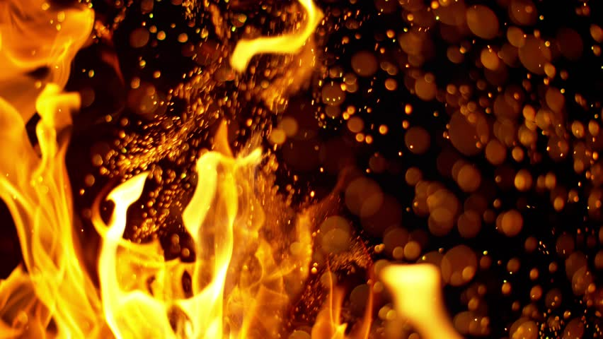 Fire flames and sparks in super slow motion isolated on black, shooting with high speed cinema camera at 4K