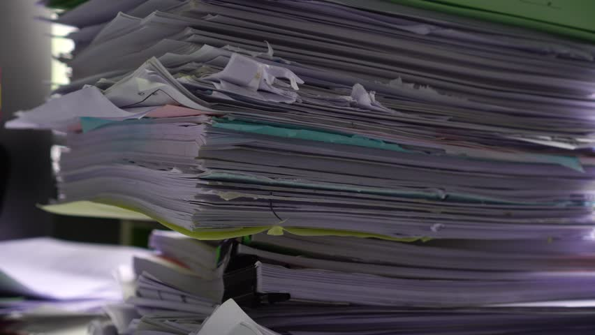 Piled heap high recycle documents folders, Stack business paper on desk messy or paperwork in office. Old Document achieves in print folder doc forms, use recycling for save | Shutterstock HD Video #1026694469