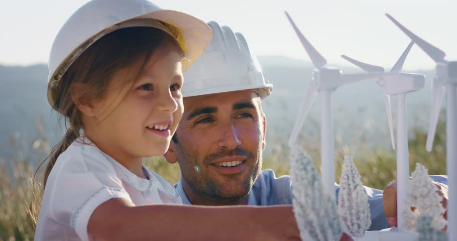 A father engineer shows his project to his daughter for the construction of a wind farm. The daughter is interested in renewable energy. Concept of: family, engineering, future love for nature. | Shutterstock HD Video #1026694994