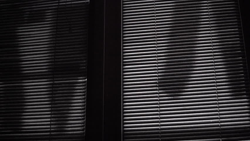 Horror scene of moving laundry shades on venetian blinds at night   Shutterstock HD Video #1026722876