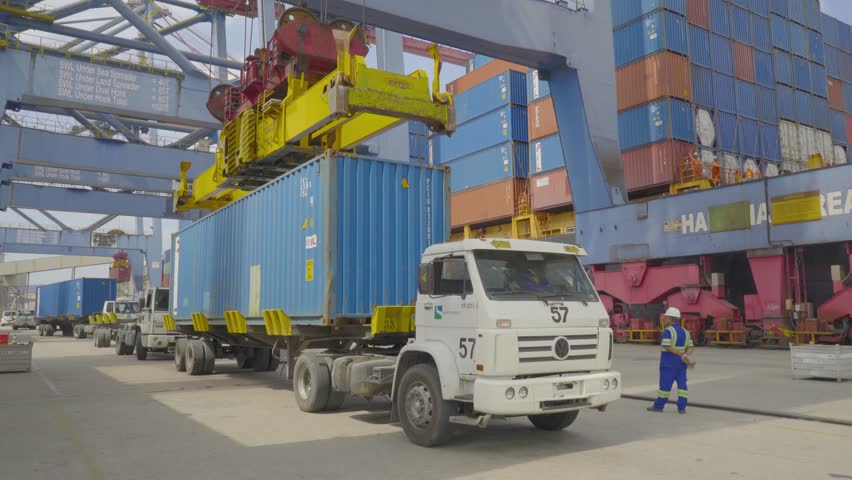 Santos / SP / Brazil - June - 2018: busy port working area harbour with trucks and cranes in Brazil