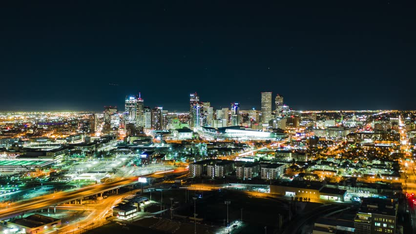 Aerial Night Time-Lapse of Denver Colorado with traffic.