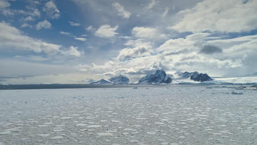 Antarctica Timelapse. Snow Iceberg Drift Wild Nature Aerial View. Epic Glacier Surface Landscape. Frozen Antarctic Climate Change Pole Continent Scenery Drone Hyperlapse Overview Shot Footage 4K (UHD)