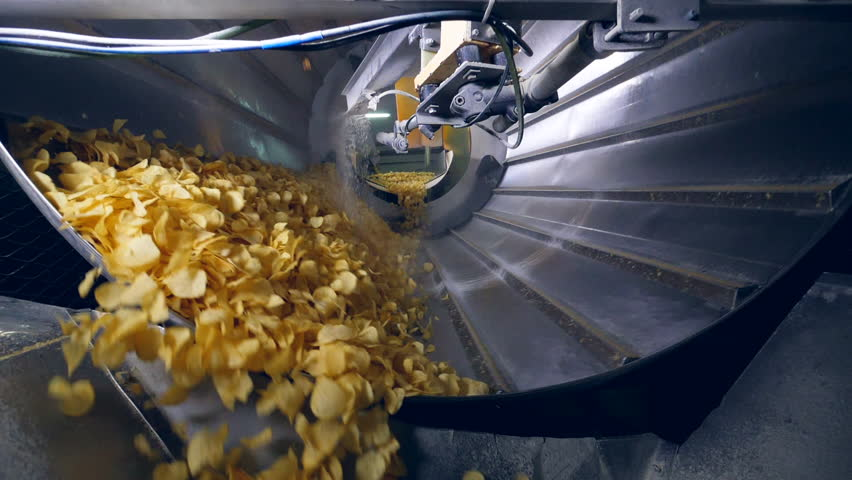 Sorted potato chips mixing with a flavor enhancers. | Shutterstock HD Video #1026739877