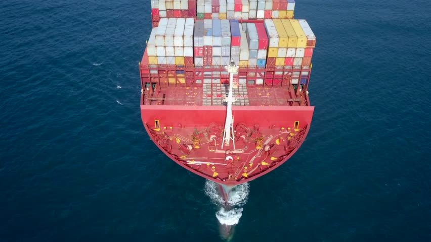 Ultra large container ship (ULCV 366 Meters long) at sea - Aerial footage.