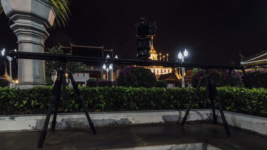 A 4K time lapse of a motion control device on a slider at Loha Prasat, Bangkok, Thailand. | Shutterstock HD Video #1026755948