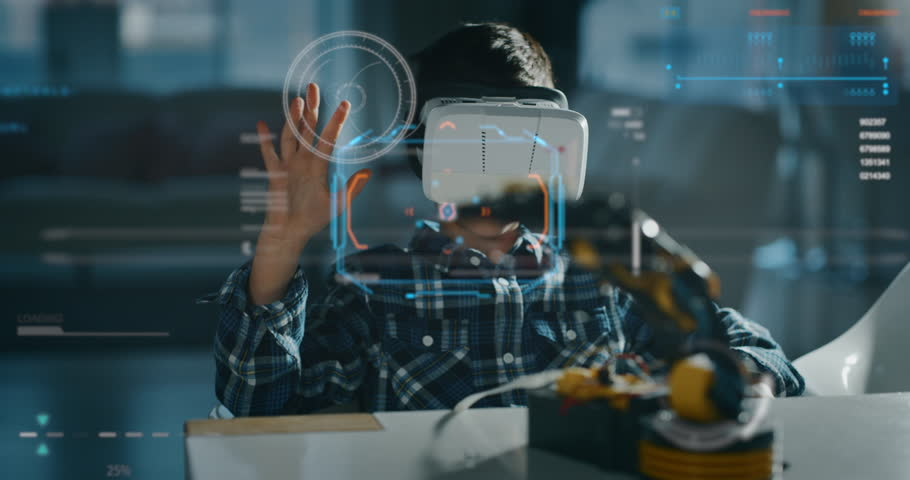 Portrait of boy playing with mechanical arm toy using vr glasses with futuristic augmented reality hologram in living room in slow motion. #1026766076