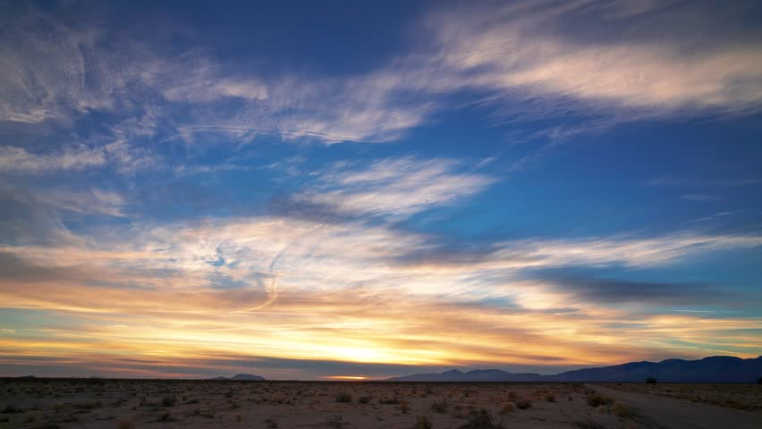 Golden Fire Sunset Time Lapse in Mojave Desert with blue, red, and purple light