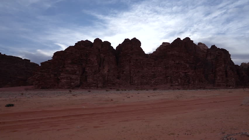 A Timelapse of Clouds Moving Above The Desert of Wadi Rum | Shutterstock HD Video #1026783992
