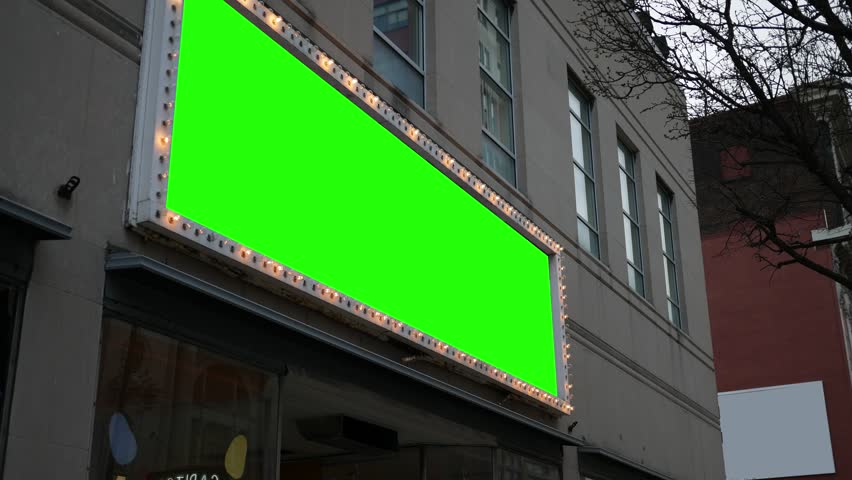 Green screen light up sign over business