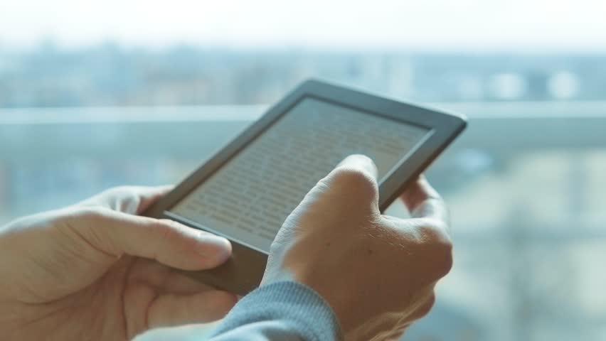 Using e-reader tablet, reading ebook   Shutterstock HD Video #1026792722