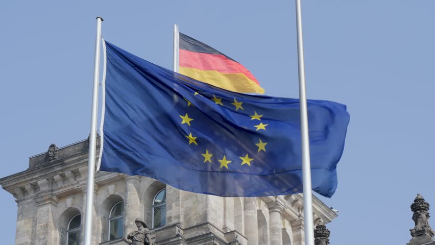 Berlin, Germany - March 23, 2019: The German national flag flying in the wind together with the EU flag