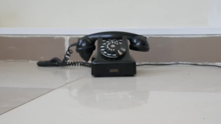 Old vintage telephone on the floor. Zoom in and zoom out old vintage telephone   Shutterstock HD Video #1026803681
