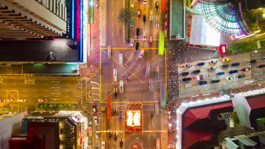 Night illuminated flight over singapore traffic street crossroad aerial topdown panorama 4k timelapse | Shutterstock HD Video #1026803774