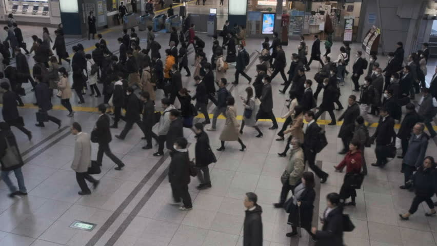TOKYO, JAPAN - APRIL 1ST, 2019. Top view of huge commuter crowd walking at Shinagawa Railway Station interior building during the morning rush hour. Cinematic color graded. | Shutterstock HD Video #1026808970