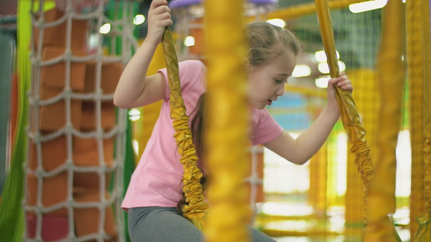Girl passes attraction with barriers | Shutterstock HD Video #1026819773